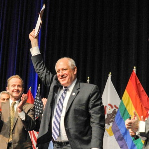 Illinois Gov. Pat Quinn triumphantly show the Illinois Religious Freedom and Marriage Fairness Act that he had just signed on Nov. 20, 2013. (Photo courtesy Illinois Governor's Office.)