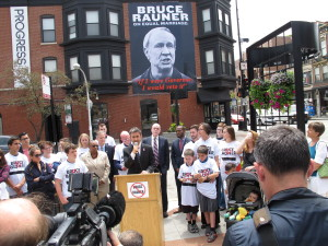 Equality Illinois CEO Bernard Cherkasov addresses the media at the unveiling of the Rauner poster