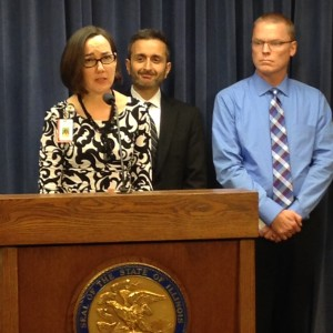 Rep. Kelly Cassidy discusses her bill to protect LGBT youth from dangerous conversion therapy at a Springfield press conference with Equality Illinois CEO Bernard Cherkasov (center) and Jeff Zacharias, of the New Hope Recovery Center