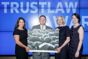 Serena Grant, Director of TrustLaw, (on left) presents the award to Mike Ziri of Equality Illinois and Marjorie Lindblom and Seirian Thomas of Kirkland & Ellis